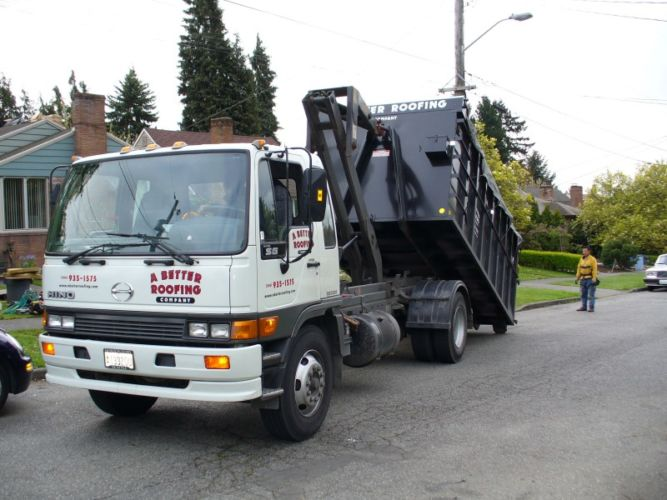A Better Roofing Company Dumpster Trucks